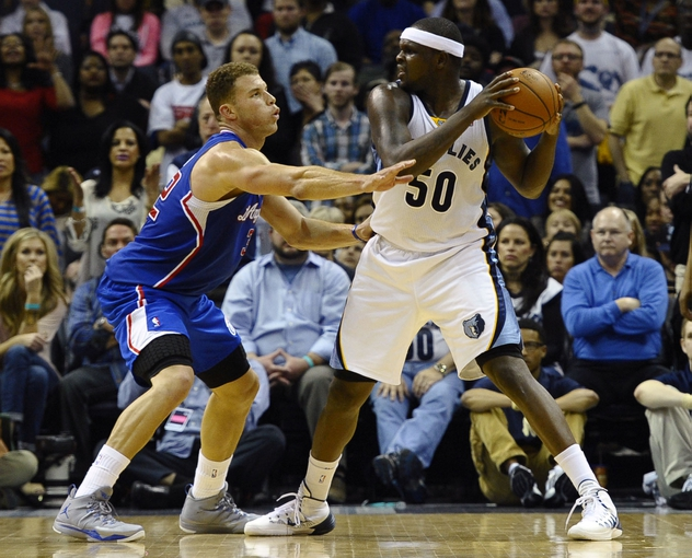 Feb 21, 2014; Memphis, TN, USA; Memphis Grizzlies power forward Zach Randolph (50) holds the ball as Los Angeles Clippers power forward Blake Griffin (32) defends at FedExForum. The Grizzlies won 102 - 96. Mandatory Credit: Justin Ford-USA TODAY Sports