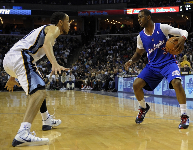 Feb 21, 2014; Memphis, TN, USA; Los Angeles Clippers point guard Chris Paul (3) dribbles the ball as Memphis Grizzlies small forward Tayshaun Prince (21) defends at FedExForum. The Grizzlies won 102 - 96. Mandatory Credit: Justin Ford-USA TODAY Sports