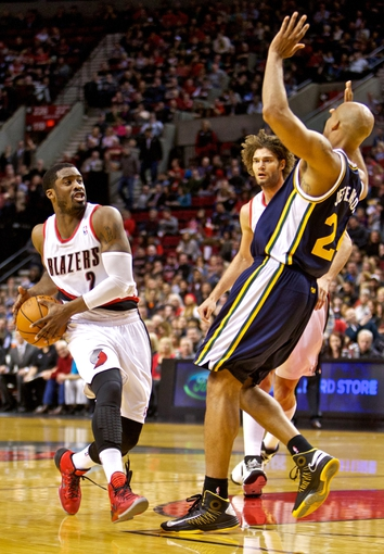 Feb 21, 2014; Portland, OR, USA; Portland Trail Blazers shooting guard Wesley Matthews (2) drives into Utah Jazz small forward Richard Jefferson (24) during the second quarter at the Moda Center. Mandatory Credit: Craig Mitchelldyer-USA TODAY Sports
