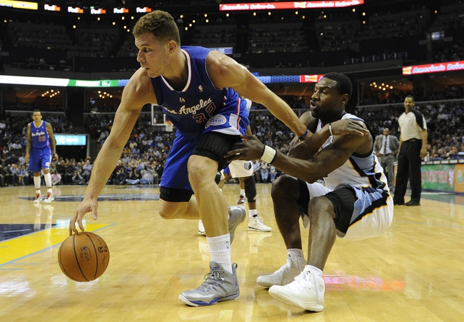 Feb 21, 2014; Memphis, TN, USA; Los Angeles Clippers power forward Blake Griffin (32) dribbles the ball as Memphis Grizzlies shooting guard Tony Allen (9) defends at FedExForum. The Grizzlies won 102 - 96. Mandatory Credit: Justin Ford-USA TODAY Sports