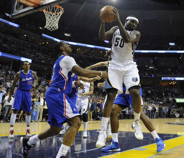 Feb 21, 2014; Memphis, TN, USA; Memphis Grizzlies power forward Zach Randolph (50) battles for the rebound with Los Angeles Clippers point guard Chris Paul (3) at FedExForum. The Grizzlies won 102 - 96. Mandatory Credit: Justin Ford-USA TODAY Sports
