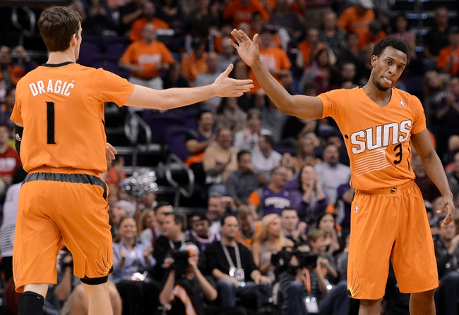 Feb 21, 2014; Phoenix, AZ, USA; Phoenix Suns guard Goran Dragic (1) celebrates with guard Ish Smith (3) against the San Antonio Spurs in the first half at US Airways Center. The Suns won 106-85. Mandatory Credit: Jennifer Stewart-USA TODAY Sports