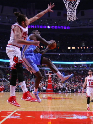 Feb 21, 2014; Chicago, IL, USA; Denver Nuggets center J.J. Hickson (7) is defended by Chicago Bulls center Joakim Noah (13) during the first half at the United Center. Mandatory Credit: Dennis Wierzbicki-USA TODAY Sports