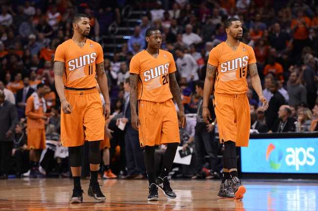 Feb 21, 2014; Phoenix, AZ, USA; Phoenix Suns forward Markieff Morris (11), guard Archie Goodwin (20) and forward Marcus Morris (15) walk out onto the court during the second half against the San Antonio Spurs at US Airways Center. The Suns defeated the Spurs 106-85. Mandatory Credit: Jennifer Stewart-USA TODAY Sports