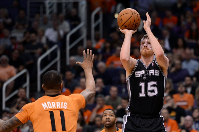 Feb 21, 2014; Phoenix, AZ, USA; San Antonio Spurs forward Matt Bonner (15) puts up a shot over the Phoenix Suns forward Markieff Morris (11) in the second half at US Airways Center. The Suns defeated the Spurs 106-85. Mandatory Credit: Jennifer Stewart-USA TODAY Sports