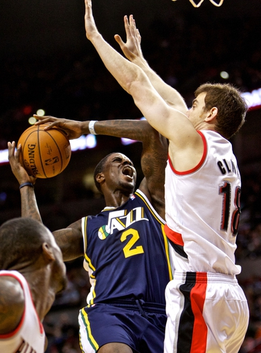 Feb 21, 2014; Portland, OR, USA; Utah Jazz power forward Marvin Williams (2) shoots over Portland Trail Blazers power forward Victor Claver (18) during the third quarter at the Moda Center. Mandatory Credit: Craig Mitchelldyer-USA TODAY Sports