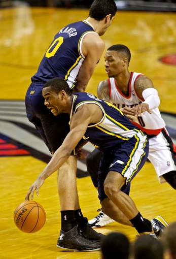 Feb 21, 2014; Portland, OR, USA; Utah Jazz point guard Alec Burks (10) runs into center Enes Kanter (0) against the Portland Trail Blazers during the fourth quarter at the Moda Center. Mandatory Credit: Craig Mitchelldyer-USA TODAY Sports
