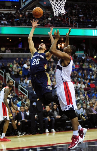 Feb 22, 2014; Washington, DC, USA; New Orleans Pelicans guard Austin Rivers (25) shoots the ball over Washington Wizards forward Kevin Seraphin (13) at Verizon Center. Mandatory Credit: Evan Habeeb-USA TODAY Sports