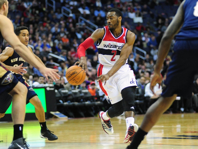 Feb 22, 2014; Washington, DC, USA; Washington Wizards guard John Wall (2) passes the ball in the third quarter against the New Orleans Pelicans at Verizon Center. Mandatory Credit: Evan Habeeb-USA TODAY Sports
