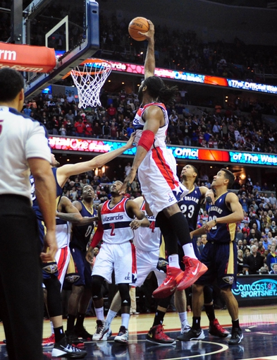 Feb 22, 2014; Washington, DC, USA; Washington Wizards forward Nene (42) dunks to score a basket  against the New Orleans Pelicans 94-93 at Verizon Center. Mandatory Credit: Evan Habeeb-USA TODAY Sports