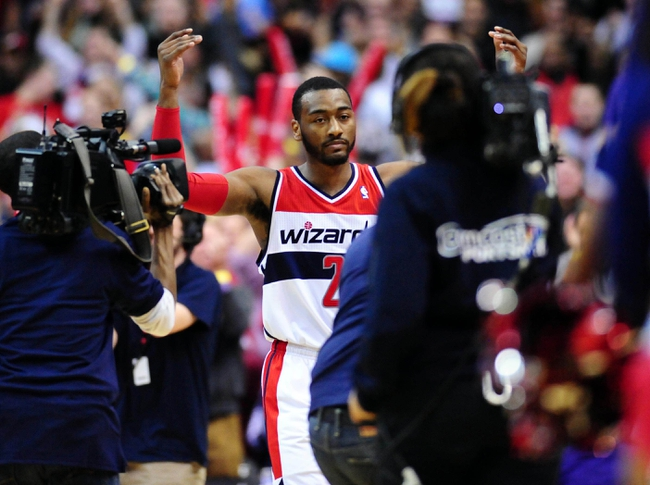 Feb 22, 2014; Washington, DC, USA; Washington Wizards guard John Wall (2) celebrates after beating the New Orleans Pelicans 94-93 at Verizon Center. Mandatory Credit: Evan Habeeb-USA TODAY Sports