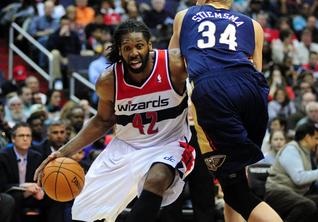 Feb 22, 2014; Washington, DC, USA; Washington Wizards forward Nene (42) is defended by New Orleans Pelicans center Greg Stiemsma (34) at Verizon Center. Mandatory Credit: Evan Habeeb-USA TODAY Sports
