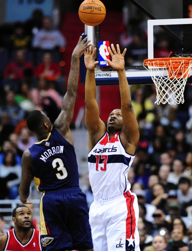 Feb 22, 2014; Washington, DC, USA; New Orleans Pelicans guard Anthony Morrow (3) shoots the ball over Washington Wizards forward Kevin Seraphin (13) at Verizon Center. Mandatory Credit: Evan Habeeb-USA TODAY Sports