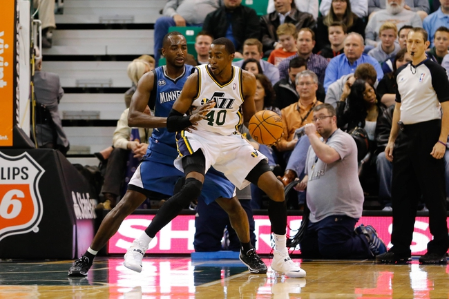 Feb 22, 2014; Salt Lake City, UT, USA; Utah Jazz small forward Jeremy Evans (40) controls the ball against Minnesota Timberwolves power forward Luc Richard Mbah a Moute (12) during the second quarter at EnergySolutions Arena. Mandatory Credit: Chris Nicoll-USA TODAY Sports