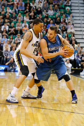 Feb 22, 2014; Salt Lake City, UT, USA; Minnesota Timberwolves point guard J.J. Barea (11) controls the ball against Utah Jazz point guard Diante Garrett (8) during the second quarter at EnergySolutions Arena. Mandatory Credit: Chris Nicoll-USA TODAY Sports