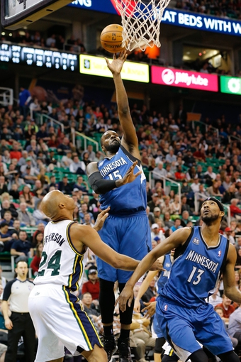 Feb 22, 2014; Salt Lake City, UT, USA; Minnesota Timberwolves small forward Shabazz Muhammad (15) shoots the ball over Utah Jazz small forward Richard Jefferson (24) during the second quarter at EnergySolutions Arena. Mandatory Credit: Chris Nicoll-USA TODAY Sports