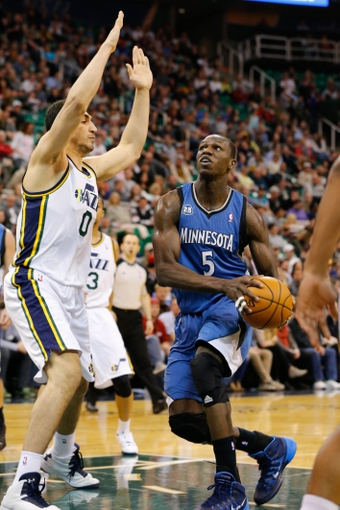 Feb 22, 2014; Salt Lake City, UT, USA; Minnesota Timberwolves center Gorgui Dieng (5) moves to the basket against Utah Jazz center Enes Kanter (0) during the second quarter at EnergySolutions Arena. Mandatory Credit: Chris Nicoll-USA TODAY Sports