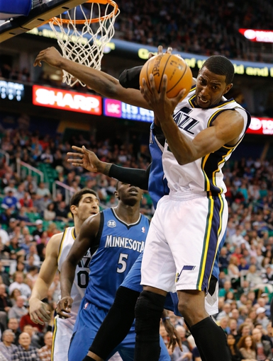 Feb 22, 2014; Salt Lake City, UT, USA; Utah Jazz small forward Jeremy Evans (40) grabs a rebound against the Minnesota Timberwolves during the second quarter at EnergySolutions Arena. Mandatory Credit: Chris Nicoll-USA TODAY Sports