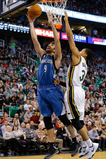Feb 22, 2014; Salt Lake City, UT, USA; Minnesota Timberwolves point guard Ricky Rubio (9) lays the ball up to the basket while being guarded by Utah Jazz point guard Trey Burke (3) during the second quarter at EnergySolutions Arena. Mandatory Credit: Chris Nicoll-USA TODAY Sports