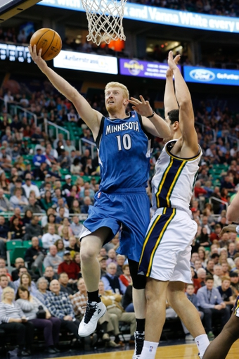 Feb 22, 2014; Salt Lake City, UT, USA; Minnesota Timberwolves small forward Chase Budinger (10) shoots the ball after getting past Utah Jazz center Enes Kanter (0) during the second quarter at EnergySolutions Arena. Mandatory Credit: Chris Nicoll-USA TODAY Sports