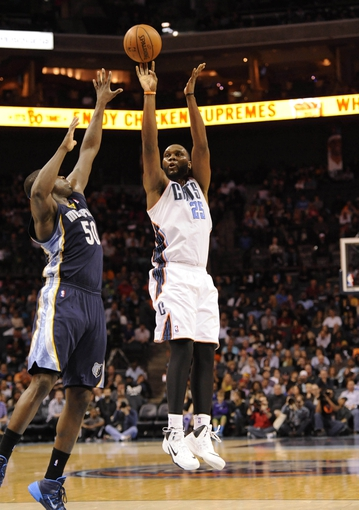 Feb 22, 2014; Charlotte, NC, USA; Charlotte Bobcats center Al Jefferson (25) shoots as he is defended by Memphis Grizzlies forward Zach Randolph (50) during the second half of the game at Time Warner Cable Arena. Bobcats win 92-89. Mandatory Credit: Sam Sharpe-USA TODAY Sports