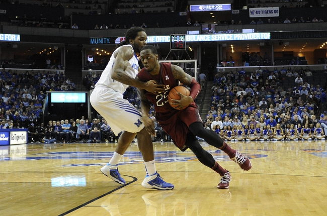 Feb 21, 2014; Memphis, TN, USA; Temple Owls guard Quenton DeCosey (25) drives to the basket against Memphis Tigers forward Shaq Goodwin (2) during the game at FedExForum. Mandatory Credit: Justin Ford-USA TODAY Sports