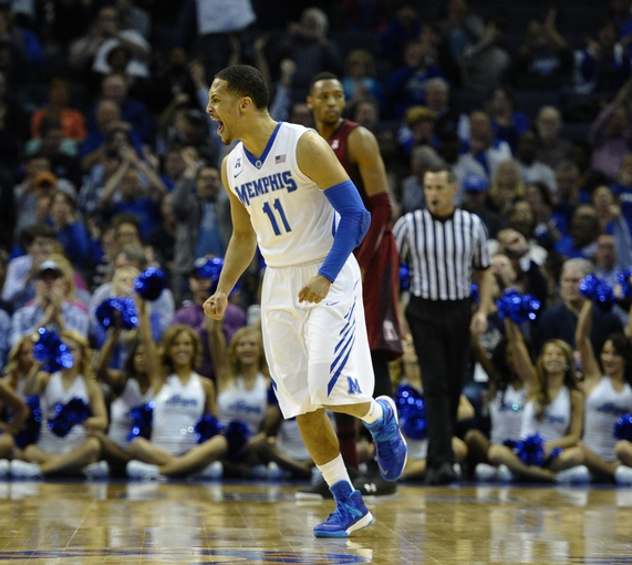 Feb 21, 2014; Memphis, TN, USA; Memphis Tigers guard Michael Dixon Jr. (11) celebrates after basket against the Temple Owls during the game at FedExForum. Mandatory Credit: Justin Ford-USA TODAY Sports
