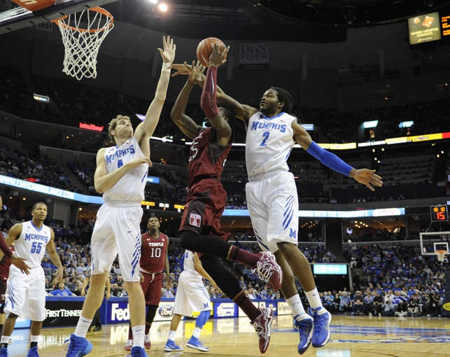 Feb 21, 2014; Memphis, TN, USA; Memphis Tigers forward Shaq Goodwin (2) and Memphis Tigers forward Austin Nichols (4) defend Temple Owls guard Quenton DeCosey (25) during the game at FedExForum. Mandatory Credit: Justin Ford-USA TODAY Sports