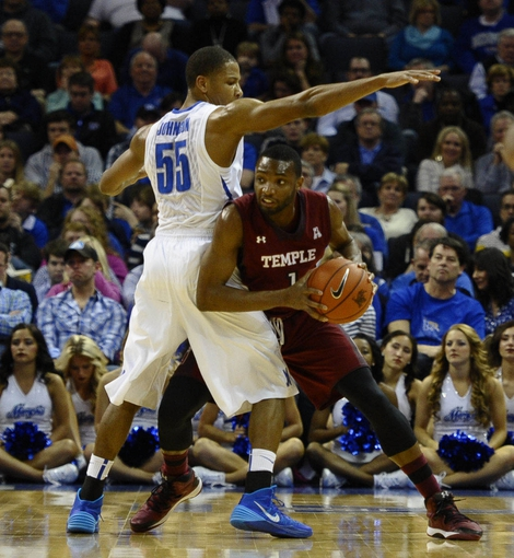 Feb 21, 2014; Memphis, TN, USA; Temple Owls guard Josh Brown (1) is guarded by Memphis Tigers guard Geron Johnson (55) during the game at FedExForum. Mandatory Credit: Justin Ford-USA TODAY Sports