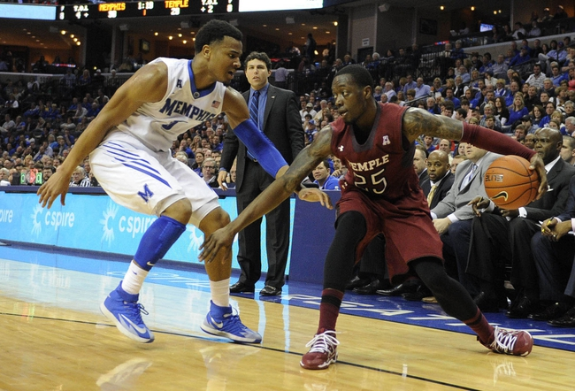 Feb 21, 2014; Memphis, TN, USA; Temple Owls guard Quenton DeCosey (25) handles the ball against Memphis Tigers guard Chris Crawford (3) during the game at FedExForum. Mandatory Credit: Justin Ford-USA TODAY Sports