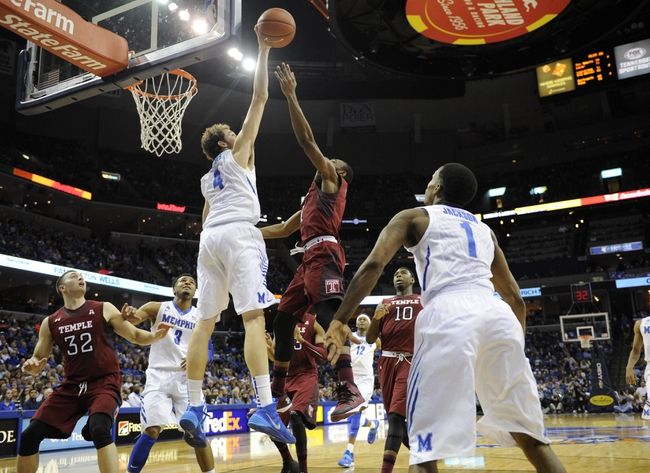 Feb 21, 2014; Memphis, TN, USA; Memphis Tigers forward Austin Nichols (4) blocks the shoot of Temple Owls guard Quenton DeCosey (25) at FedExForum. Mandatory Credit: Justin Ford-USA TODAY Sports
