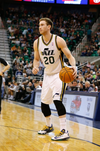 Feb 22, 2014; Salt Lake City, UT, USA; Utah Jazz shooting guard Gordon Hayward (20) dribbles the ball during the third quarter against the Minnesota Timberwolves at EnergySolutions Arena. Minnesota Timberwolves beat the Utah Jazz 121-104.  Mandatory Credit: Chris Nicoll-USA TODAY Sports