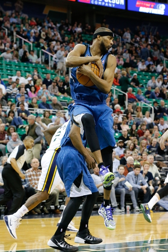 Feb 22, 2014; Salt Lake City, UT, USA; Minnesota Timberwolves small forward Corey Brewer (13) grabs a rebound during the third quarter against the Utah Jazz at EnergySolutions Arena. Minnesota Timberwolves beat the Utah Jazz 121-104.  Mandatory Credit: Chris Nicoll-USA TODAY Sports