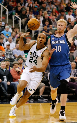 Feb 22, 2014; Salt Lake City, UT, USA; Utah Jazz small forward Richard Jefferson (24) loses the ball after being foul by Minnesota Timberwolves small forward Chase Budinger (10) during the third quarter at EnergySolutions Arena. Minnesota Timberwolves beat the Utah Jazz 121-104.  Mandatory Credit: Chris Nicoll-USA TODAY Sports