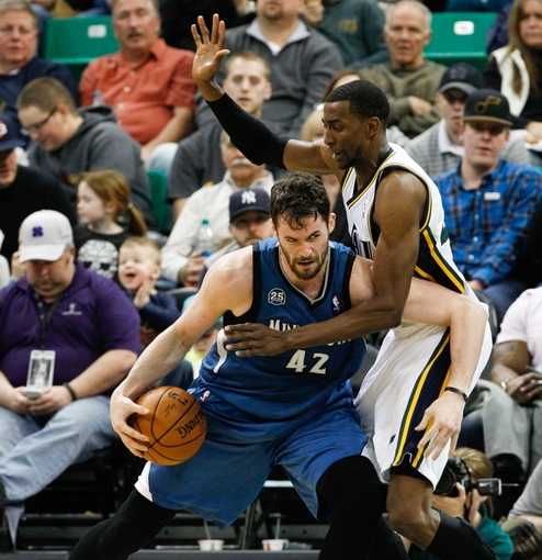 Feb 22, 2014; Salt Lake City, UT, USA; Minnesota Timberwolves power forward Kevin Love (42) controls the ball while being guarded by Utah Jazz small forward Jeremy Evans (40) during the third quarter at EnergySolutions Arena. Minnesota Timberwolves beat the Utah Jazz 121-104.  Mandatory Credit: Chris Nicoll-USA TODAY Sports