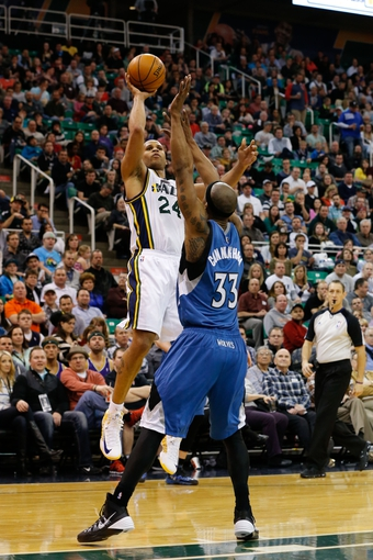 Feb 22, 2014; Salt Lake City, UT, USA; Utah Jazz small forward Richard Jefferson (24) shoots the ball over Minnesota Timberwolves power forward Dante Cunningham (33) during the third quarter at EnergySolutions Arena. Minnesota Timberwolves beat the Utah Jazz 121-104.  Mandatory Credit: Chris Nicoll-USA TODAY Sports