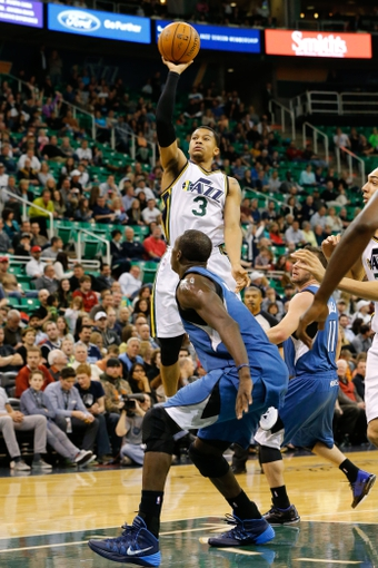 Feb 22, 2014; Salt Lake City, UT, USA; Utah Jazz point guard Trey Burke (3) shoots the ball during the fourth quarter against the Minnesota Timberwolves at EnergySolutions Arena. Minnesota Timberwolves beat the Utah Jazz 121-104.  Mandatory Credit: Chris Nicoll-USA TODAY Sports