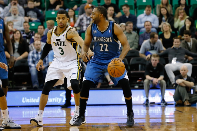 Feb 22, 2014; Salt Lake City, UT, USA; Minnesota Timberwolves point guard A.J. Price (22) dribbles the ball while being guarded by Utah Jazz point guard Trey Burke (3) during the fourth quarter at EnergySolutions Arena. Minnesota Timberwolves beat the Utah Jazz 121-104.  Mandatory Credit: Chris Nicoll-USA TODAY Sports