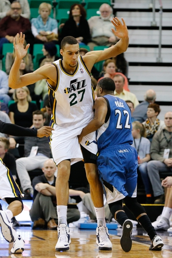 Feb 22, 2014; Salt Lake City, UT, USA; Minnesota Timberwolves point guard A.J. Price (22) goes around Utah Jazz center Rudy Gobert (27) during the fourth quarter at EnergySolutions Arena. Minnesota Timberwolves beat the Utah Jazz 121-104.  Mandatory Credit: Chris Nicoll-USA TODAY Sports