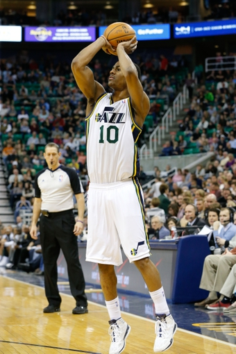 Feb 22, 2014; Salt Lake City, UT, USA; Utah Jazz point guard Alec Burks (10) shoots a jump shot against the Minnesota Timberwolves during the fourth quarter at EnergySolutions Arena. Minnesota Timberwolves beat the Utah Jazz 121-104.  Mandatory Credit: Chris Nicoll-USA TODAY Sports