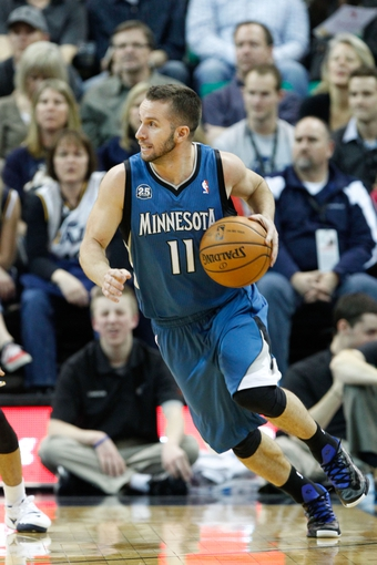 Feb 22, 2014; Salt Lake City, UT, USA; Minnesota Timberwolves point guard J.J. Barea (11) dribbles the ball against the Utah Jazz during the third quarter at EnergySolutions Arena. Minnesota Timberwolves beat the Utah Jazz 121-104.  Mandatory Credit: Chris Nicoll-USA TODAY Sports