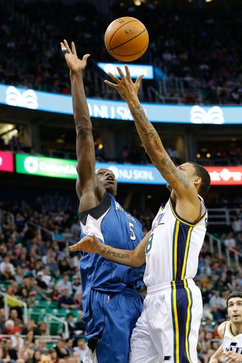 Feb 22, 2014; Salt Lake City, UT, USA; Minnesota Timberwolves center Gorgui Dieng (5) tries to block the shot of Utah Jazz point guard Diante Garrett (8) during the fourth quarter at EnergySolutions Arena. Minnesota Timberwolves beat the Utah Jazz 121-104.  Mandatory Credit: Chris Nicoll-USA TODAY Sports