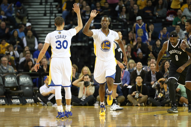 Feb 22, 2014; Oakland, CA, USA; Golden State Warriors small forward Harrison Barnes (40) high fives point guard Stephen Curry (30) after a basket against the Brooklyn Nets during the first quarter at Oracle Arena. Mandatory Credit: Kelley L Cox-USA TODAY Sports