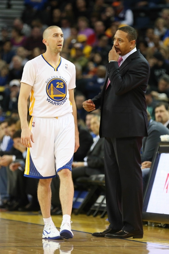 Feb 22, 2014; Oakland, CA, USA; Golden State Warriors guard Steve Blake (25) speaks to head coach Mark Jackson during the first quarter against the Brooklyn Nets at Oracle Arena. Mandatory Credit: Kelley L Cox-USA TODAY Sports