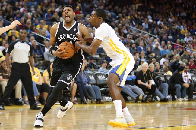 Feb 22, 2014; Oakland, CA, USA; Brooklyn Nets small forward Paul Pierce (34) drives in against Golden State Warriors shooting guard Jordan Crawford (55) during the second quarter at Oracle Arena. Mandatory Credit: Kelley L Cox-USA TODAY Sports