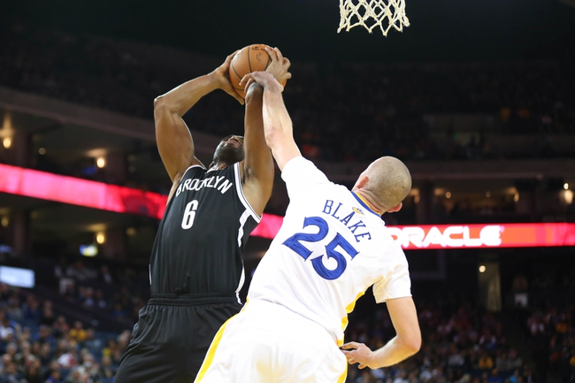 Feb 22, 2014; Oakland, CA, USA; Golden State Warriors guard Steve Blake (25) fouls Brooklyn Nets small forward Alan Anderson (6) during the second quarter at Oracle Arena. Mandatory Credit: Kelley L Cox-USA TODAY Sports