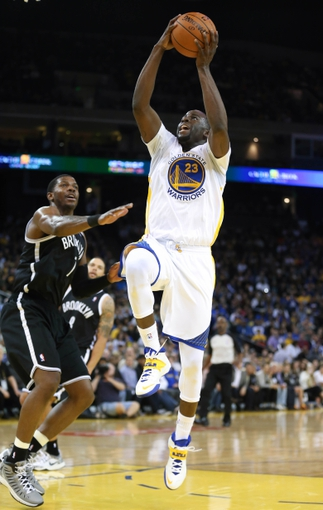 Feb 22, 2014; Oakland, CA, USA; Golden State Warriors small forward Draymond Green (23) goes up for a basket against Brooklyn Nets shooting guard Joe Johnson (7) during the third quarter at Oracle Arena. The Golden State Warriors defeated the Brooklyn Nets 93-86. Mandatory Credit: Kelley L Cox-USA TODAY Sports