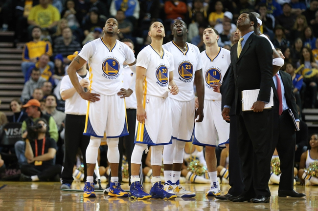 Feb 22, 2014; Oakland, CA, USA; Golden State Warriors await the officials review on a basket by against the Brooklyn Nets during the fourth quarter at Oracle Arena. The Golden State Warriors defeated the Brooklyn Nets 93-86. Mandatory Credit: Kelley L Cox-USA TODAY Sports