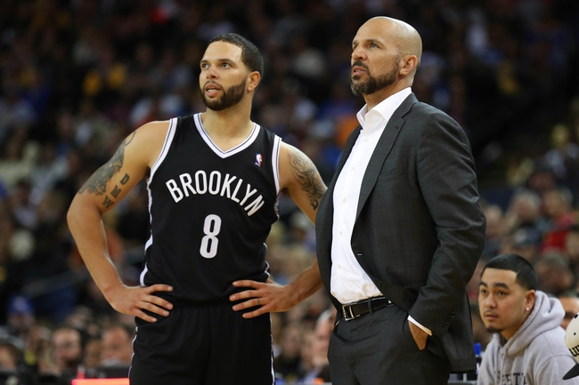 Feb 22, 2014; Oakland, CA, USA; Brooklyn Nets point guard Deron Williams (8) speaks with head coach Jason Kidd on the sideline  during the fourth quarter against the Golden State Warriors at Oracle Arena. The Golden State Warriors defeated the Brooklyn Nets 93-86. Mandatory Credit: Kelley L Cox-USA TODAY Sports