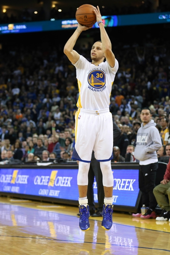 Feb 22, 2014; Oakland, CA, USA; Golden State Warriors point guard Stephen Curry (30) scores a three point basket during the fourth quarter against the Brooklyn Nets at Oracle Arena. The Golden State Warriors defeated the Brooklyn Nets 93-86. Mandatory Credit: Kelley L Cox-USA TODAY Sports